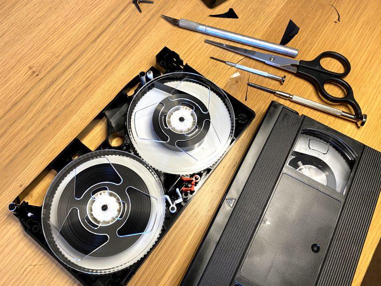 shows vhs tape cassette open
